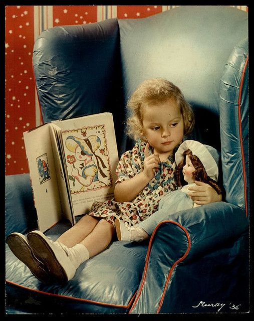 Girl reading to her doll.1936.